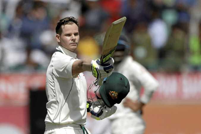 Australia's captain Steven Smith raises his bat after scoring century