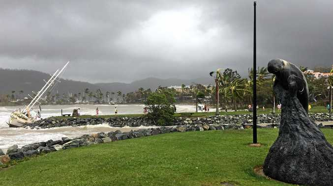 DANGEROUS DELUGE: The aftermath of Cyclone Debbie in Airlie Beach where it crossed the coast on Tuesday. Authorities are warning heavy rain is heading this way.