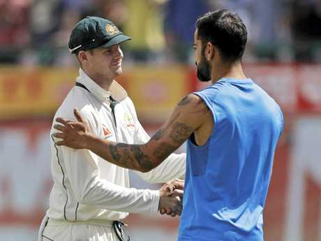 Australia's captain Steven Smith, left, and India's captain Virat Kohli shake hands