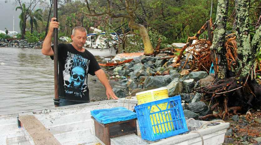 Glen McLay lived on a house boat moored off Repair Island at Shute Harbour and has lost everything.