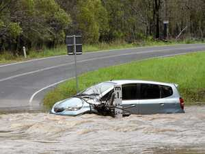 LUCKY ESCAPE: Man flees car on flooded crossing