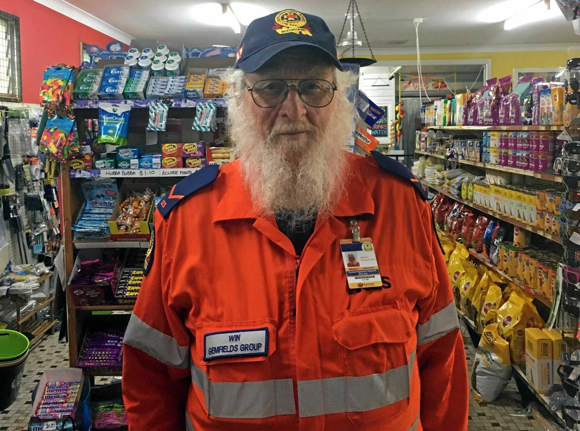 Gemfields SES member Win Knighton at the Four Square Shop in Rubyvale is one of the emergency service personnel helping locals as flash-flooding threatens to township.