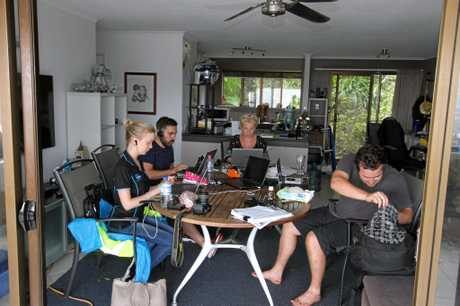 Whitsunday Times journalists Inge Hansen, Dane Lillingstone, editor Sharon Smallwood and journalist Jacob Wilson working in their makeshift office today.