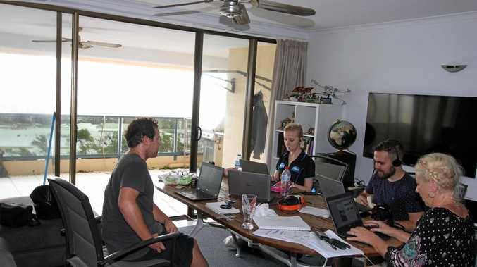 Whitsunday Times journalists Jacob Wilson, Inge Hansen and Dane Lillingstone with editor Sharon Smallwood at the makeshift Whitsunday Times office the day after Cyclone Debbie.