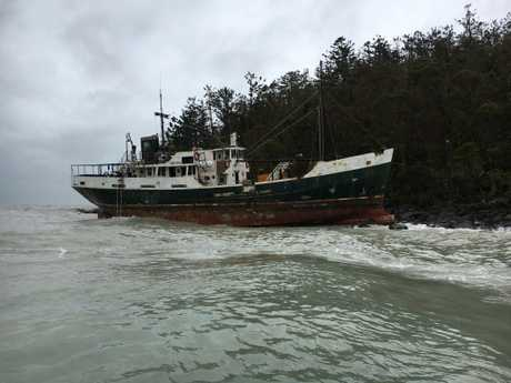 The boat washed up on rocks during Cyclone Debbie.
