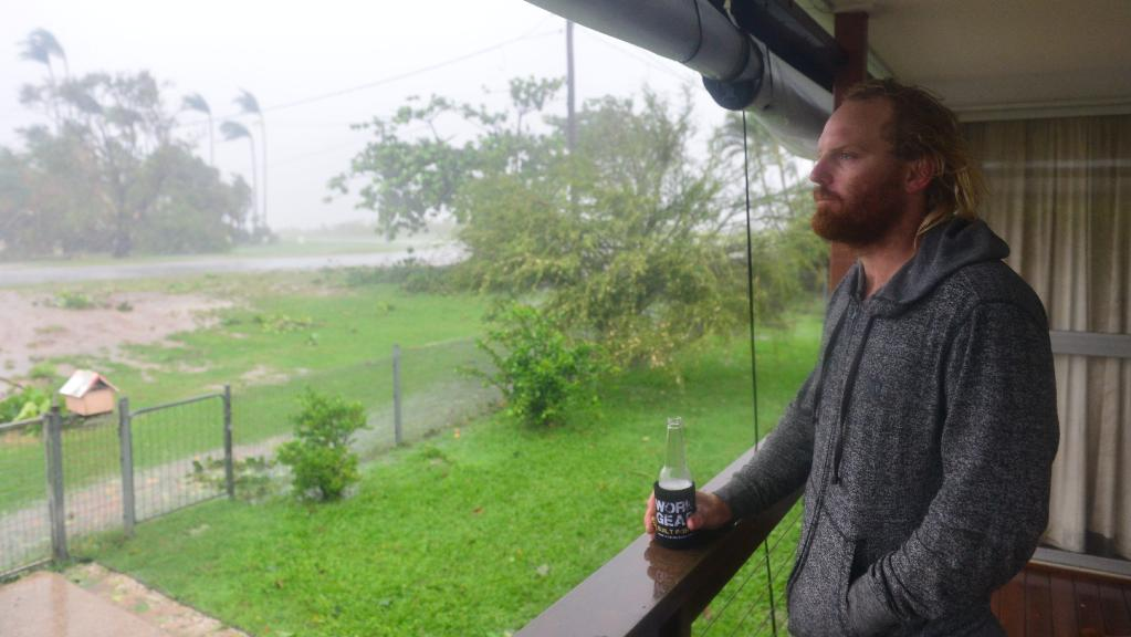 Bowen resident Daniel Halpin watches the final stage of Cyclone Debbie from his veranda. Picture: Evan Morgan