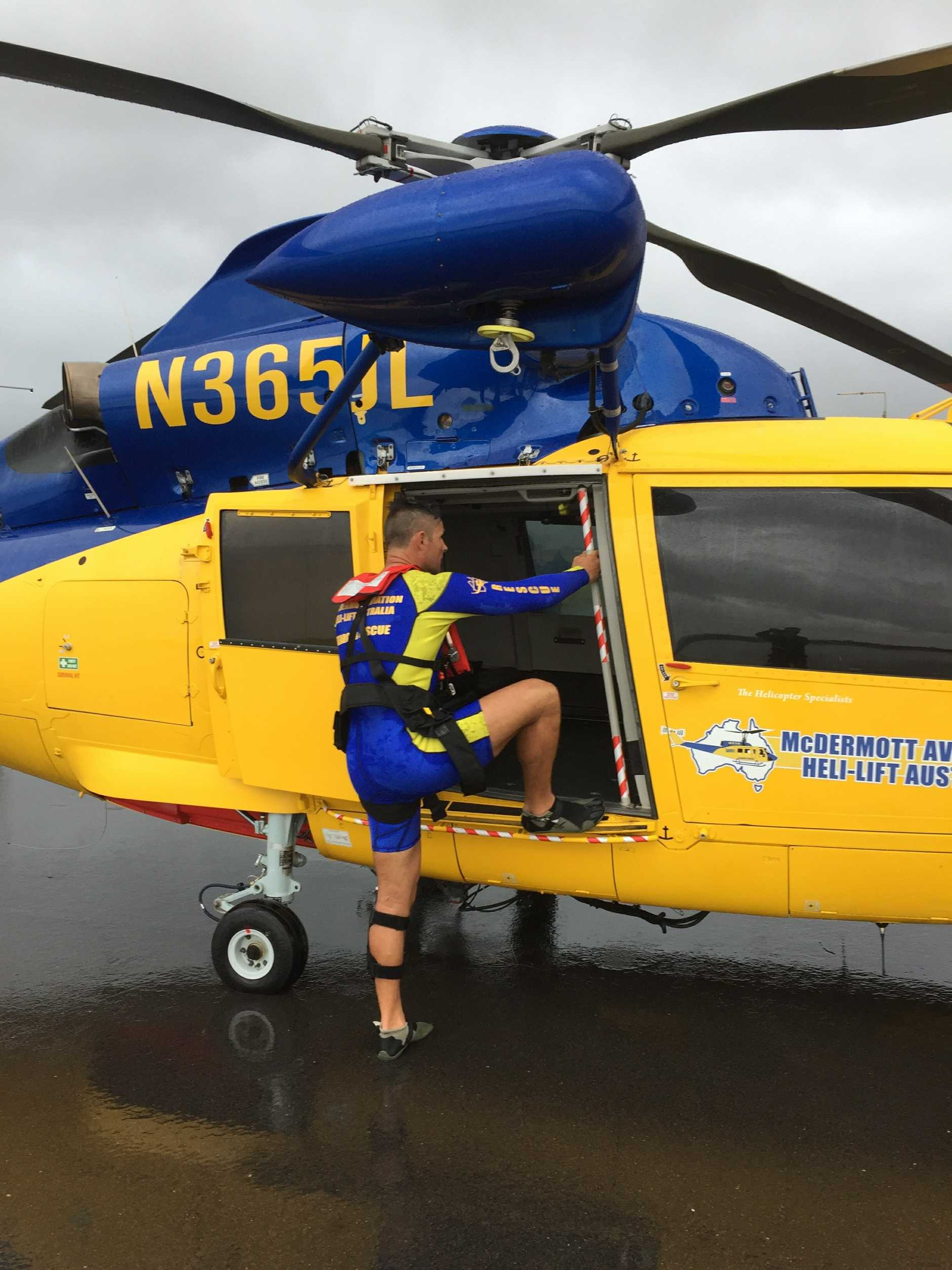 McDermott Aviation rescue swimmer professional Noosa lifeguard Isaac Smith boards a Dauphin helicopter on his way to a rescue at sea.