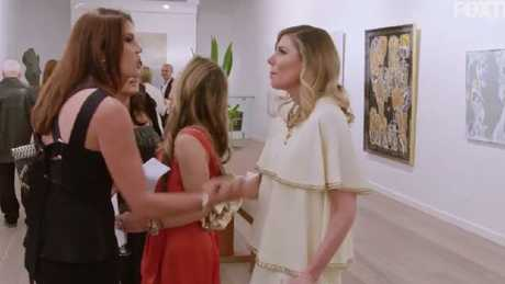The Housewives kick off in the middle of an art exhibition.