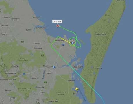 CANNOT LAND: Virgin flight VOZ1555 circles Hervey Bay airport in the middle of the rough weather.
