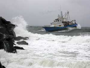 Fishing boat battles rough seas