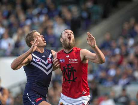 Aaron Sandilands of Fremantle and Max Gawn of Melbourne battle for the ball.