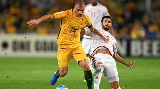 Australia's James Troisi is tackled by the United Arab Emirates' Tariq Ahmed during their World Cup qualifier.