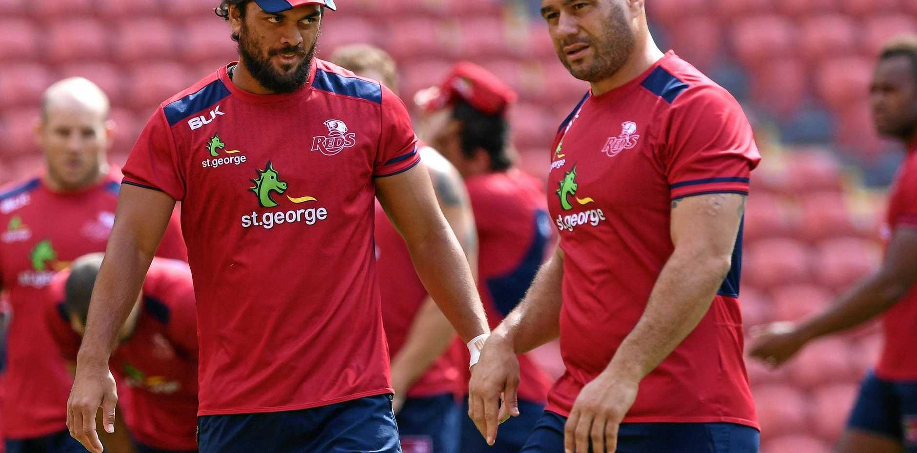 Karmichael Hunt (left) and George Smith at a Queensland Reds training session.