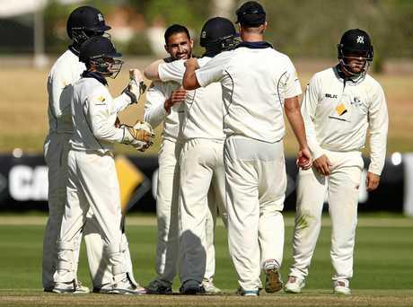 Fawad Ahmed celebrates with teammates.