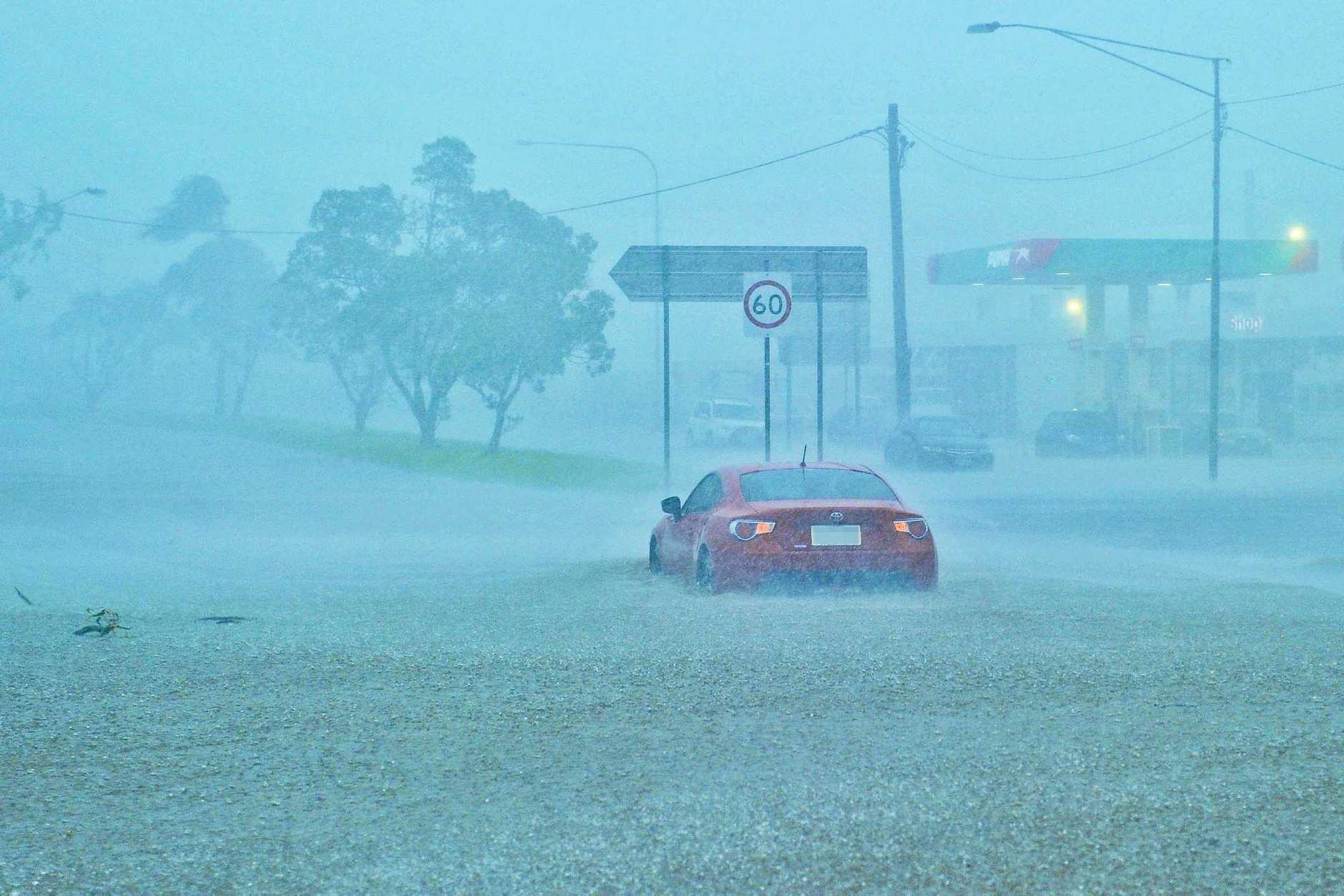 Gladstone's Dawson Rd was flooding as the aftermath of Cyclone Debbie swept through the region.