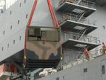 Royal Australian Navy loads up in Brisbane.