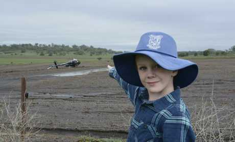 WHAT THE: Wellcamp State School student Cory Spring was shocked to see a commercial helicopter crashed in his back paddock on Thursday. Investigators are exploring how the weather contributed to the crash.