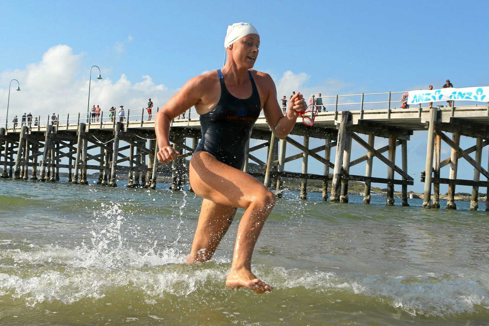 Bonnie Hancock emerges from the water to win the Coffs Ocean Swim.