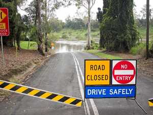 Cars crash in flood waters