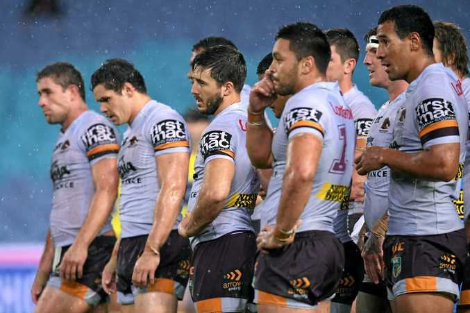 The Broncos look on following a try scored by Josh Reynolds  at ANZ Stadium