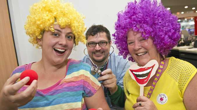 FUNNY FACES: Staff from the Toowoomba Plaza Commonwealth Bank (from left) Jodie Hammond, Troy Hulin and branch manager Vicki Pearce dress as clowns to raise funds for Clown Doctors who work in hospitals to raise the spirits of sick kids.