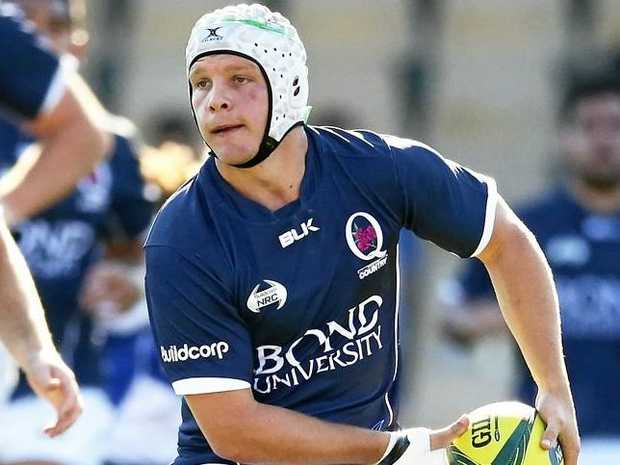 Mack Mason with the ball playing for Queensland Country during round five of the last year's NRC.