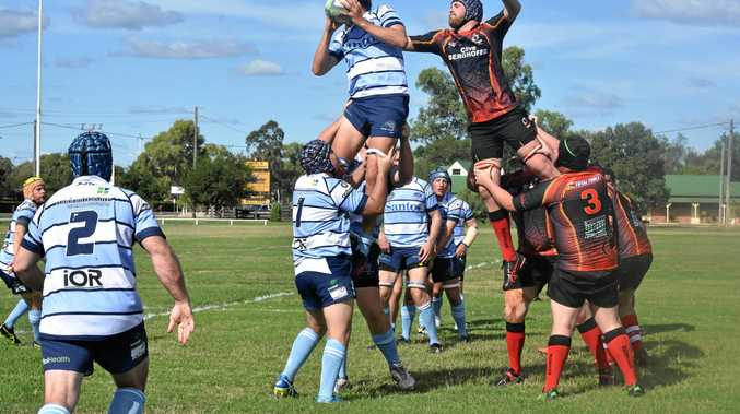 Roma (blue) and Highfields battle it out at Roma last week during round one of the 2017 Risdon Cup.