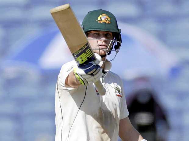 Australian captain Steve Smith celebrates a half-century against India.