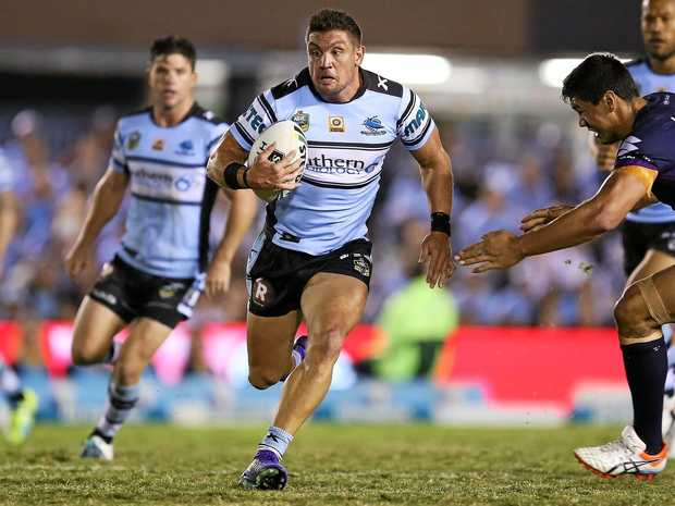Chris Heighington of the Sharks makes a run.