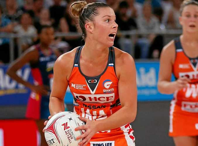 Taylah Davies of the Giants goes to throw the ball during the round-six Super Netball match against the Vixens at Hisense Arena.