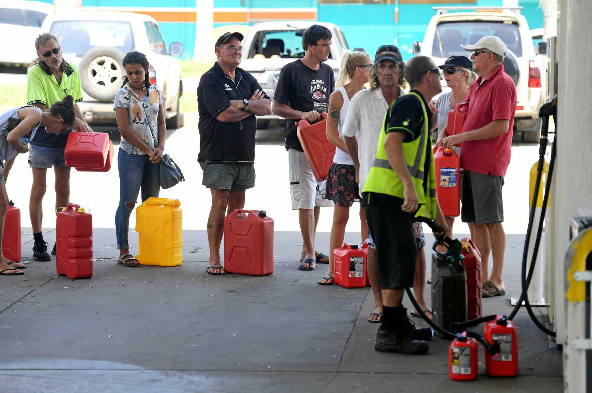 Locals queue up for petrol in Airlie Beach, Friday, March 31, 2017. Cyclone Debbie has hit Queensland's north coast on Tuesday as a category 4 cyclone, causing wide spread damage. (AAP Image/Dan Peled) NO ARCHIVING