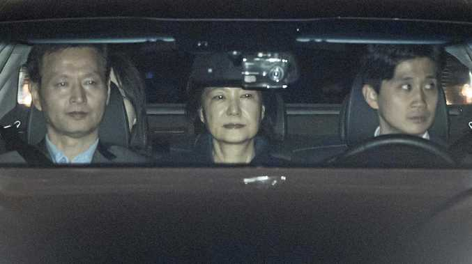A car carrying former South Korean president Park Geun-hye enters a detention house in the city of Uiwang, just south of Seoul.
