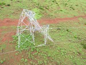 Floods severely damage power towers