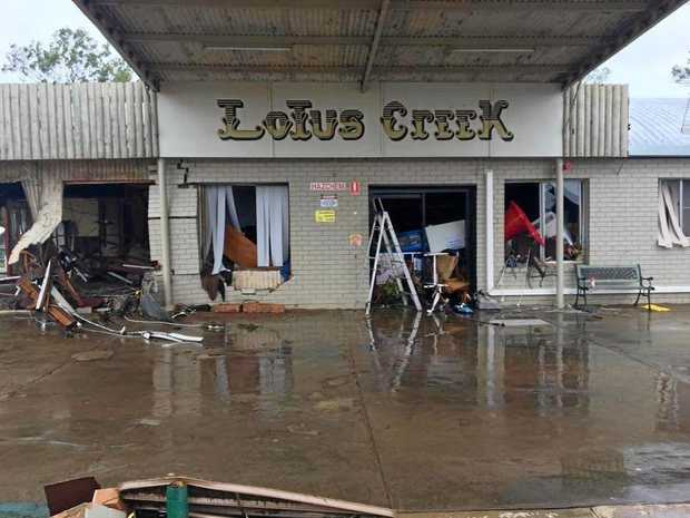 DESTROYED: Lotus Creek Service Station, north of Marlborough, was destroyed by raging floodwaters that swept through after Cyclone Debbie. INSET: Sandy Petrie with grandchildren Joseph and Claire Olsson.