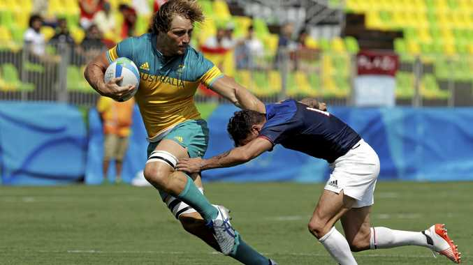 Australia's Jesse Parahi (left) avoids a tackle by France's Terry Bouhraoua at 2016 Rio Olympics.