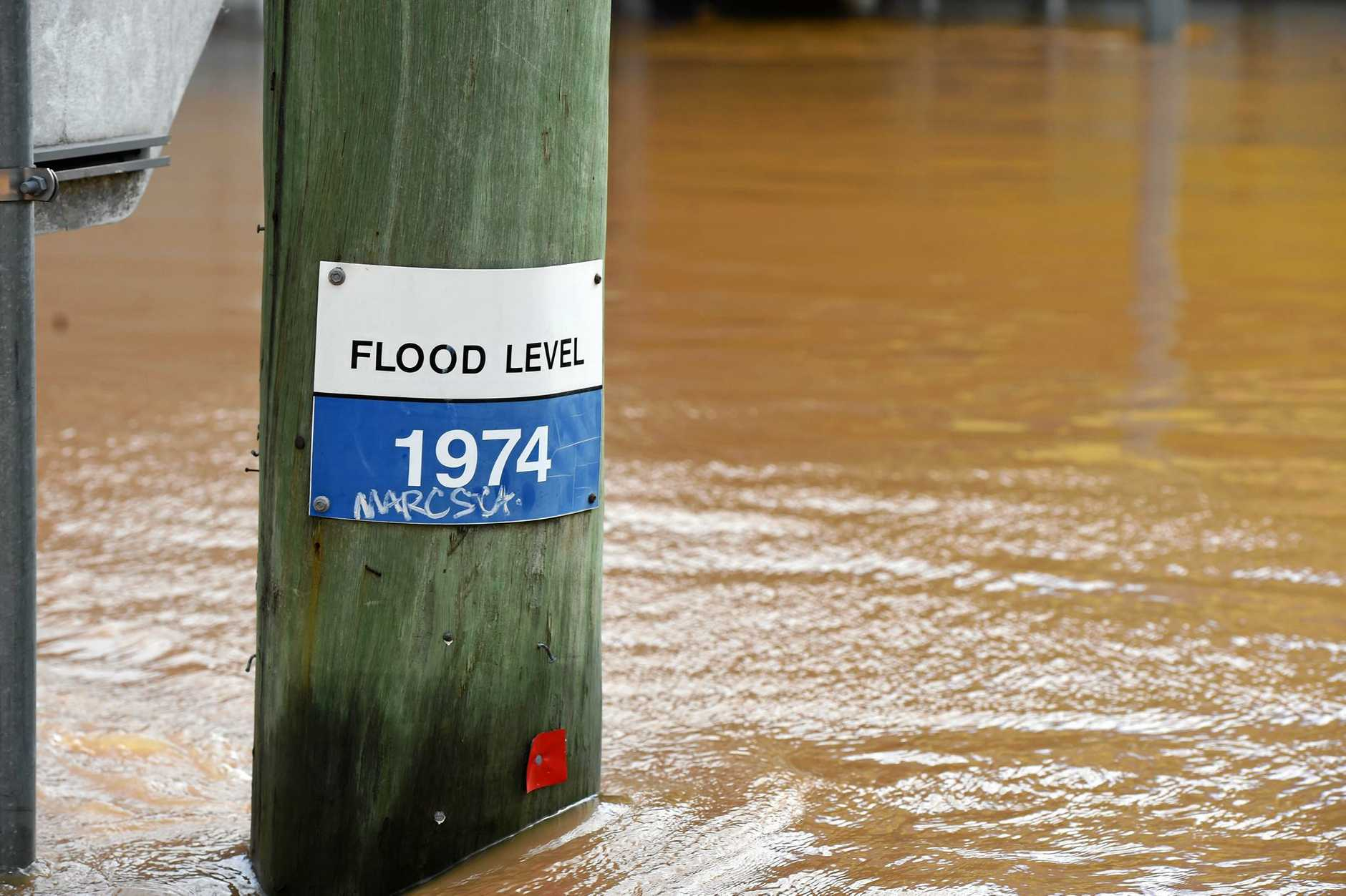 The flood water near reaches 1974 levels in North Lismore.