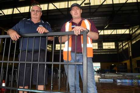 Sergeant John Dickinson and Whitsunday Councillor Ron Petterson have been spending their waking hours lending a hand at the Jubilee Pocket evacuation centre.