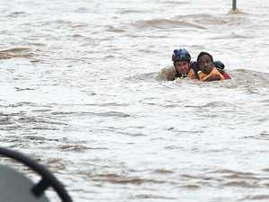 AMAZING PHOTOS: Man rescued as waters rage around him