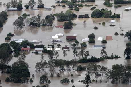 An entire suburb is submerged outside Ipswich, west of Brisbane, Australia, Wednesday, Jan. 12, 2011. Emergency sirens blared across Australia's third-largest city Wednesday as floodwaters that have torn a deadly path across the northeast poured into an empty downtown, swamping neighborhoods in what may be Brisbane's worst flooding in 100 years.