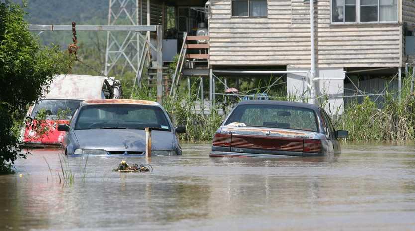 Flooded cars in a yard at Depot Hill. Photo Allan Reinikka / The Morning Bulletin ROK020111flood-a16