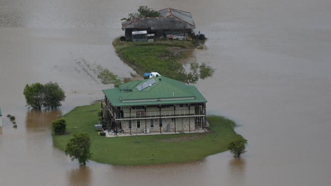 A home isolated by floodwaters near Murwillumbah, in northern NSW. Picture: Nigel Hallett