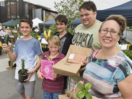 New Toowoomba residents Paul and Elizabeth Phillips, with sons (from left) David, Xavier and Thomas love the Toowoomba Farmers Market at new location Walton Stores, Saturday, April 1, 2017.