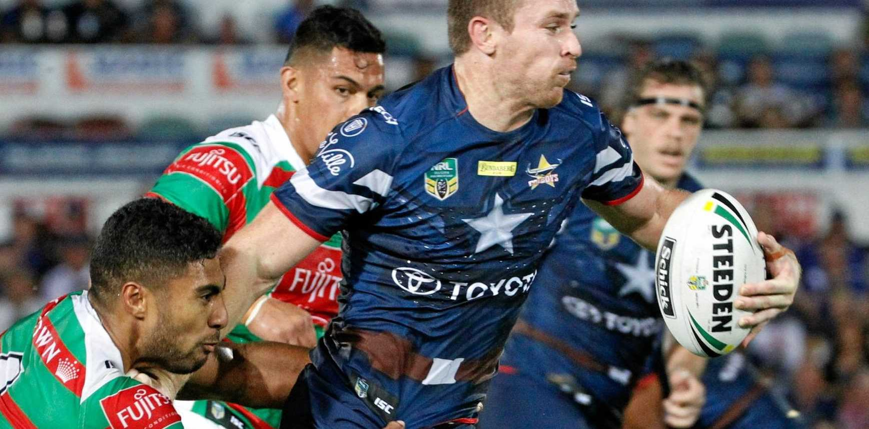Michael Morgan of the Cowboys is tackled by the Rabbitohs.
