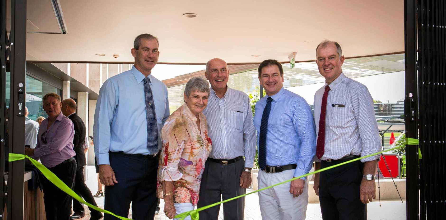 Mick Curran, Dulcie Dyne, Warren Truss, Llew O'Brien and Tony Perrett cut the ribbon at the Gympie Aquatic Recreation Centre.