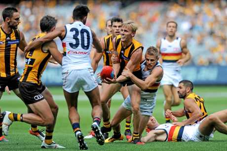 Will Langford of the Hawks is tackled by David Mackay of the Crows.