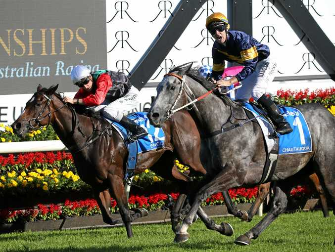 Jockey Tommy Berry on Chautauqua stands up in his saddle as they win the Darley TJ Smith Stakes race during The Championships.