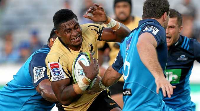 Sione Mafileo of the Blues tackles Isi Naisarani of the Force.