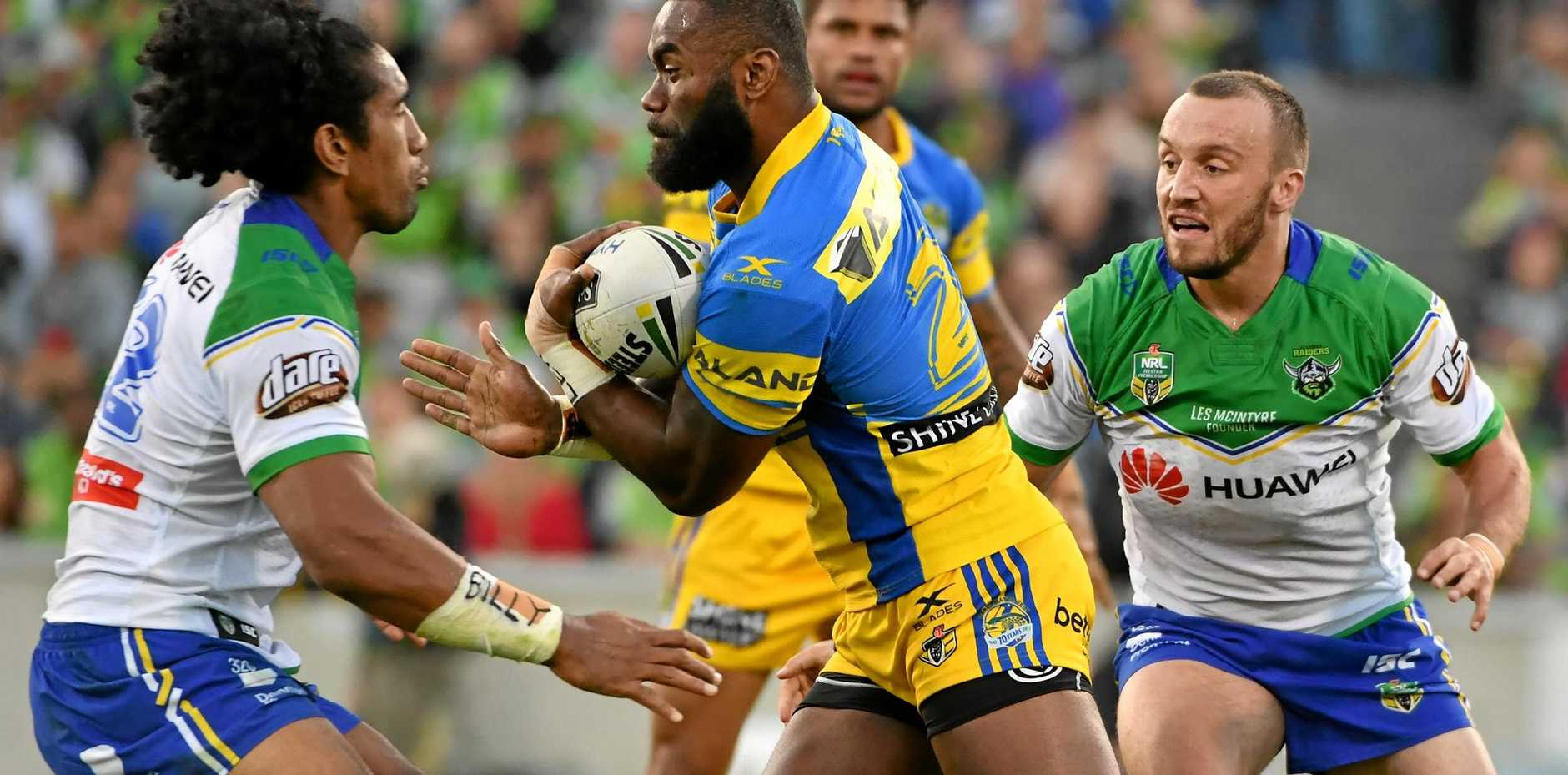 Semi Radradra of the Eels is tackled by Iosia Soliola (left) of the Raiders.