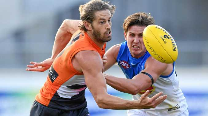 Callan Ward (left) of the Giants competes for the ball with David Swallow of the Suns.
