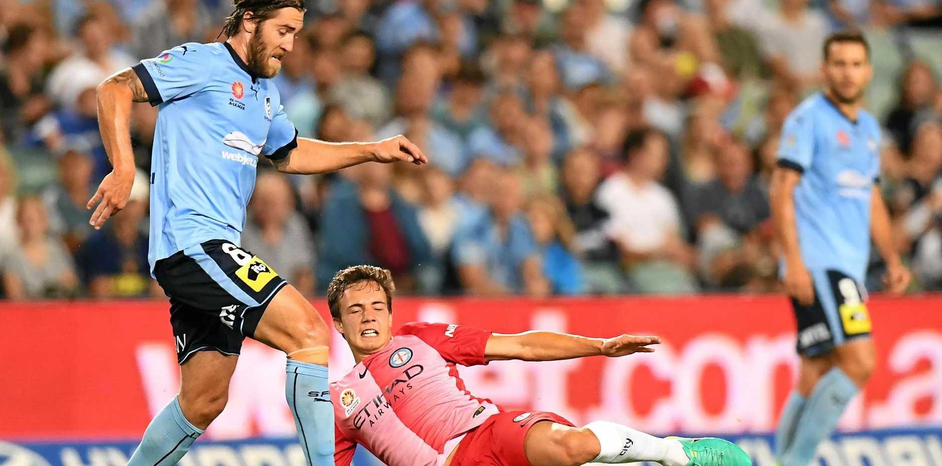 Sydney's Joshua Brilliante is tackled by City's Denis Genrau.